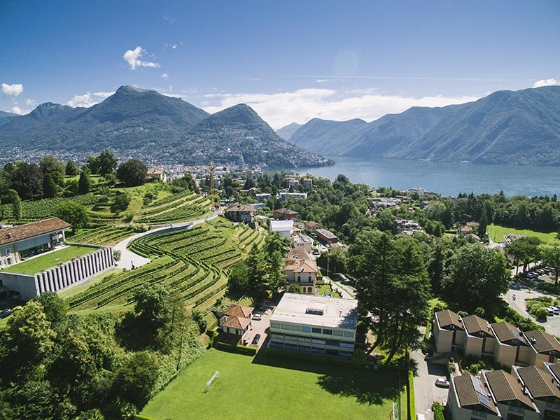 A view over the Lugano area, with Franklin's North Campus in the foreground and Lake Lugano in the background. (Photo credit: Franklin University Switzerland)