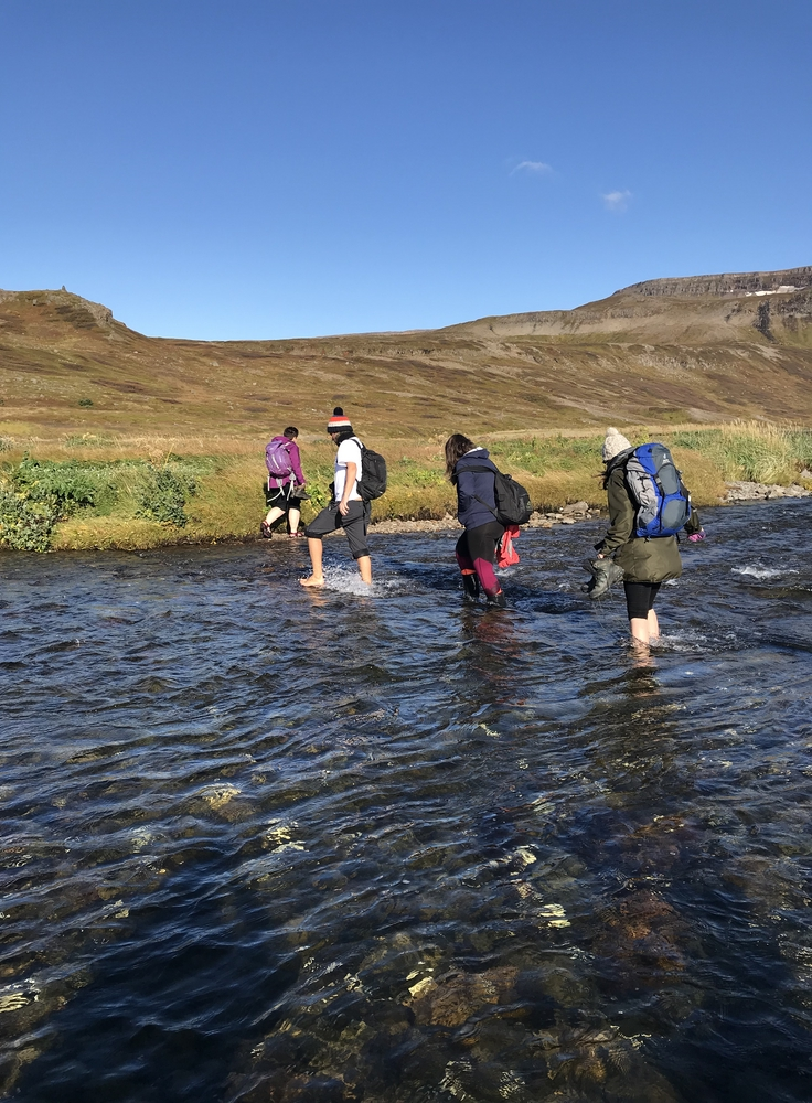 Wading the river at Stekkeyri to reach the old whaling station. Photo: Catherine Chambers.