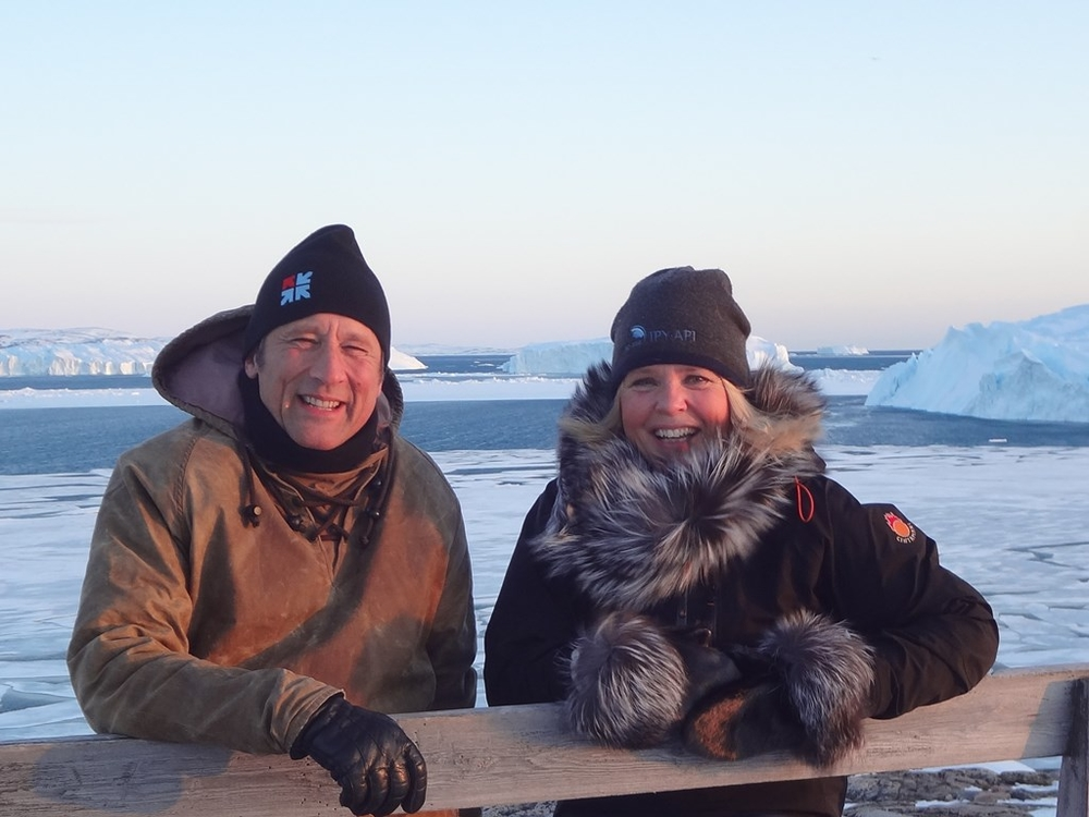 Peter Weiss, director of the University Centre of the Westfjords, together with Joan Nymand Larsen from the Stefansson Arctic Institute and professor at University of Akureyri, the other participant from Iceland, with Ilulissat Kangerlua in the background.
