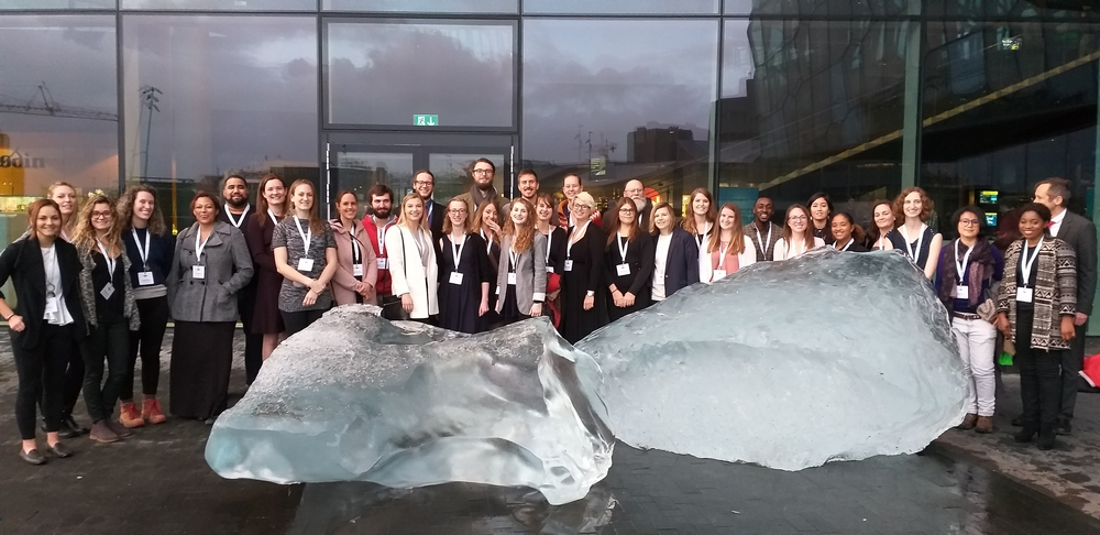 Students, staff and faculty at the Arctic Circle in front of Icebergs from Kommuneqarfik Sermersooq Municipality in Greenland.