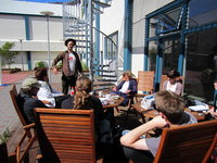 Class moves outside as poet Eir�kur �rn Nor�dahl visits the 2011 Icelandic Field School Group for a lecture at the University Centre.