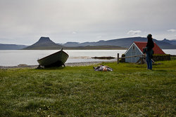 Relaxing by the old wooden boat Vigur-Breiður.